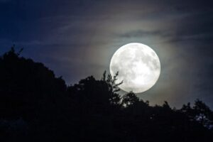 a moon shone brightly in the sky